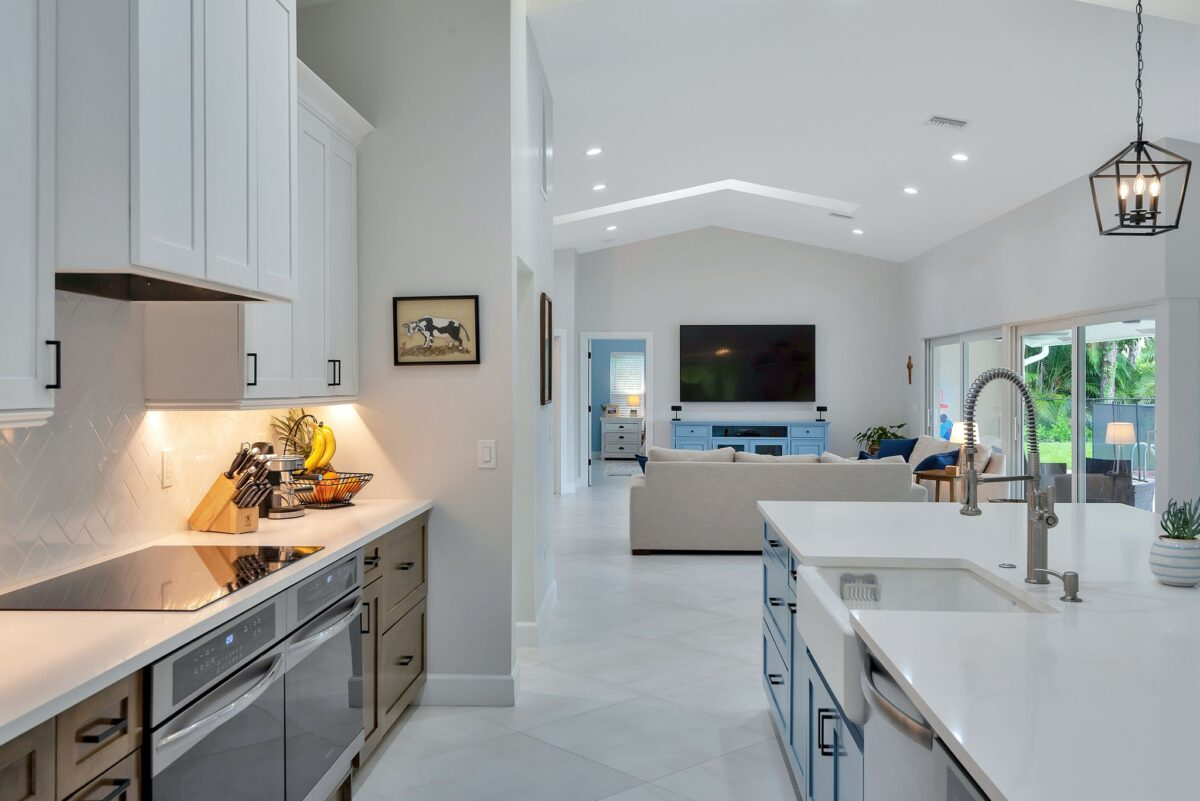 Large, bright and airy open floor plan kitchen with view to family room featuring sky lighting.