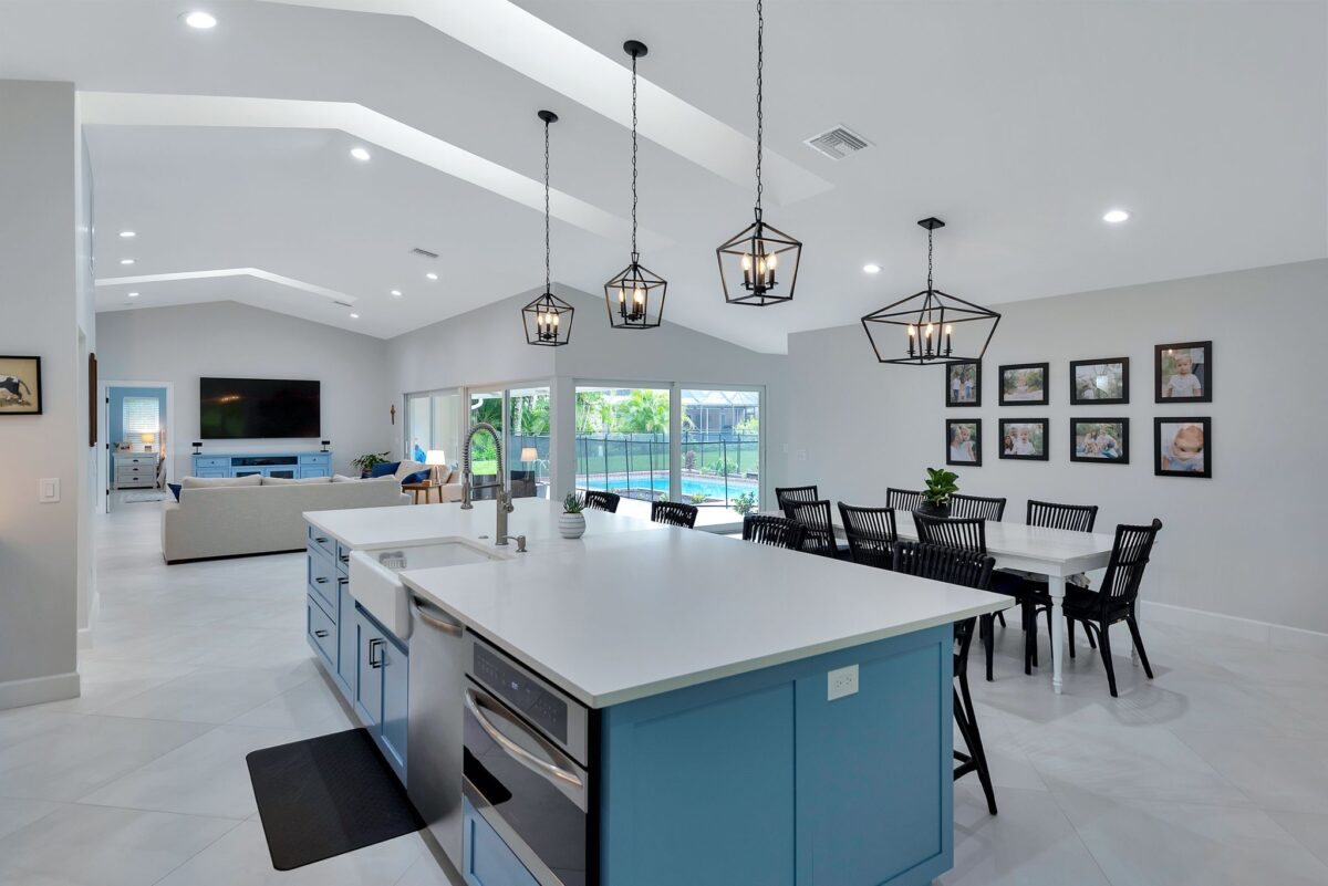 Coastal kitchen renovation with open floor concept and tall ceilings that allow lots of light.
