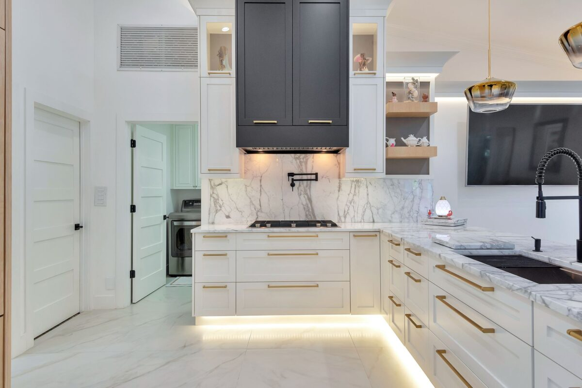 Stunning South Florida Kitchen Remodel featuring white and grey Carrara marble countertops.